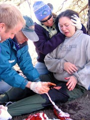 The Wilderness First Responder course has students participate in scenarios involving fake blood and gore to imitate an emergency situation.