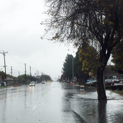 With rain in the forecast this week, watch out for slick roads and minor flooding
