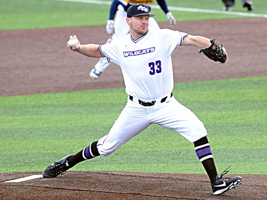 ACU starting pitcher Jonathan Nicholson throws a pitch with a Quinnipiac runner at first base in the fifth inning. Nicholson threw six strong innings to pick up a victory in the Wildcats' 10-9 win over the Bobcats on Friday, Feb. 16, 2018 at Crutcher Scott Field.