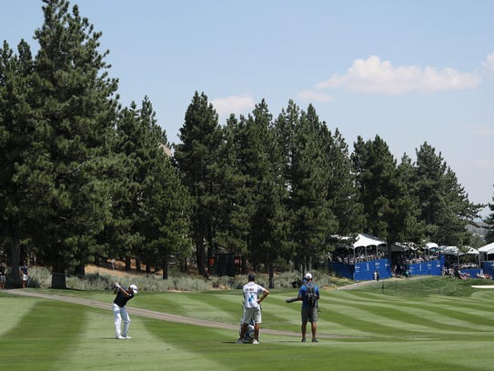 Ryan Palmer plays his second shot on the 18th hole
