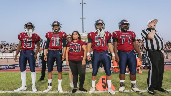 Focused. Members of La Quinta High School football before the coin toss. The La Quinta varsity football team won Friday's home non-conference game against Notre Dame (Riverside, CA) by a score of 28-10.