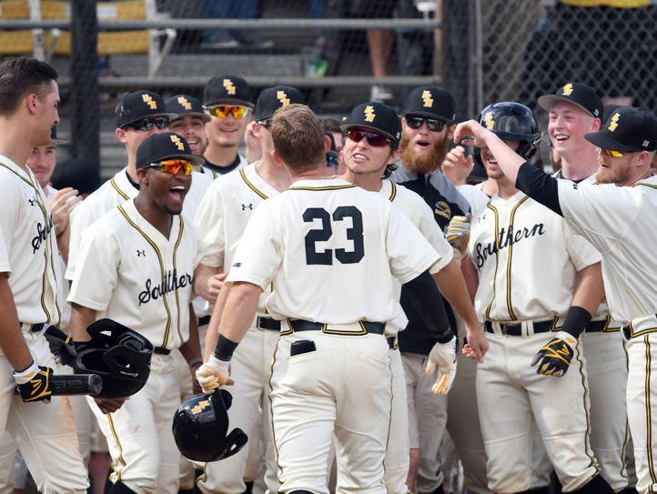 Southern Miss' Luke Reynolds celebrates with teammates