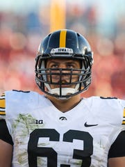 Iowa offensive lineman Austin Blythe waits for a play to come in against Iowa State on Saturday, Sept. 12, 2015.