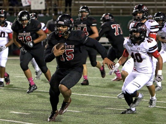 Patrick Johnston/Times Record News Wichita Falls High's Stephen Gaines (15) breaks past Braswell's Luis Hernandez (40) for a 41-yard touchdown run Friday night at Memorial Stadium.