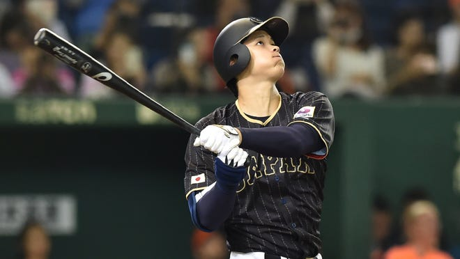 Japan's Shohei Ohtani follows a double in the seventh inning during the international friendly baseball match between Japan and the Netherlands at the Tokyo Dome on November 13, 2016. / AFP / KAZUHIRO NOGI        (Photo credit should read KAZUHIRO NOGI/AFP/Getty Images)