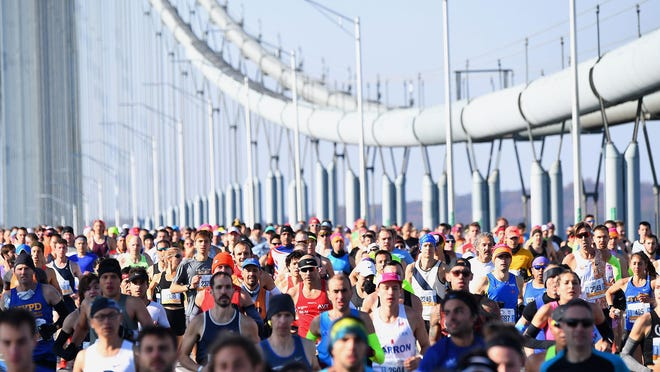Runners cross the Verrazzano-Narrows Bridge during the 2019 TCS New York City Marathon in New York on Nov. 3, 2019. This year's marathon has been canceled due to the coronavirus.