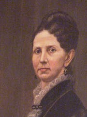 Photo of oil portrait on wall in the Statehouse of Lovina Streight.