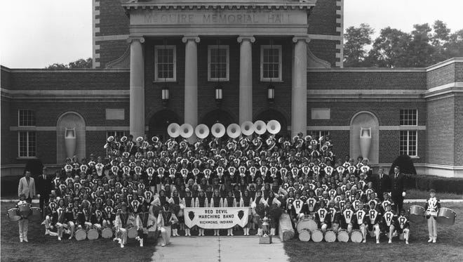 The 237-member Richmond High School Marching Band stands in front of McGuire Hall. The band won Indiana's State Fair Band Day competition in 1973 and participated in the 1974 Tournament of Roses.