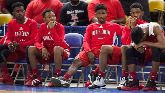 North Caddo players look dejected on the bench during double overtime in their 66-56 loss to Madison Prep in the LHSAA Boy's Top 28 Semi-Finals in Lake Charles March 10, 2016.