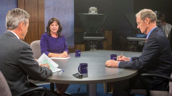 Secretary of state candidates Democrat Terry Goddard, right, and Republican Michele Reagan prepare to debate in the half-hour Arizona Horizon program with Ted Simons, on Channel 8 studios, Tuesday, Oct. 7, 2014.