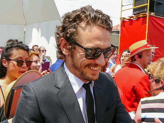Actor James Franco greets members of the crowd Saturday after speaking at Senior Convocation at Schoellkopf Field at Cornell University.