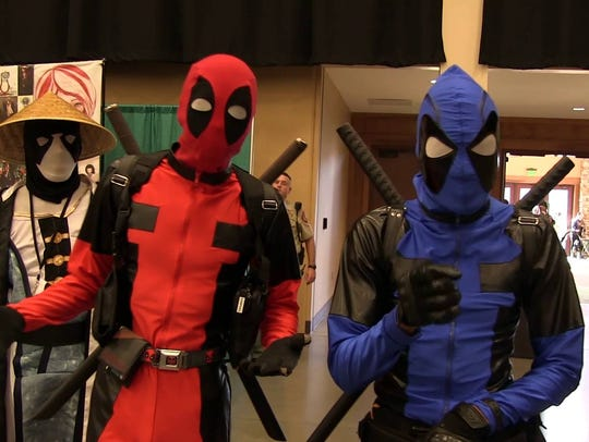 Two Yama-Con attendees dress up as Deadpool.