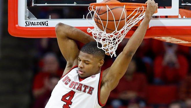North Carolina State's Dennis Smith Jr. dunks against Virginia Tech.