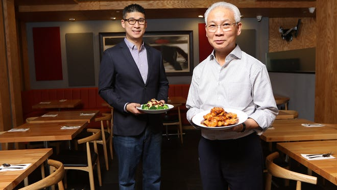 T.S. Ma Chinese Cuisine Owner, Thomas Ma and his son, Chris Ma pose for a photograph in the Wyckoff restaurant, Wednesday, November 29, 2017.