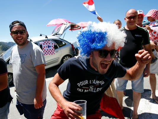 Spectators cheer the riders in Tourmalet pass  during the the eighth stage of the Tour de France cycling race over 184 kilometers (114.3 miles) with start in Pau and finish in Bagneres-de-Luchon, France, Saturday, July 9, 2016. (AP Photo/Peter Dejong)