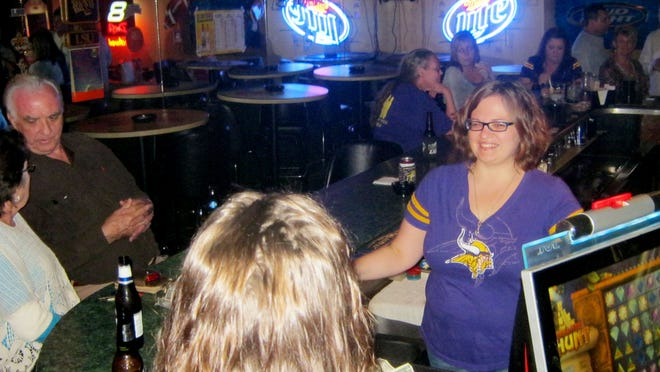 Bartender Beven Lex chats with customers at Friends Lounge on Kings Highway.