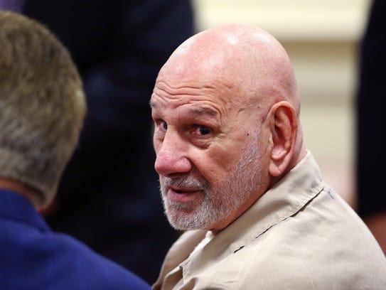 Convicted murderer James Koedatich talks to defense