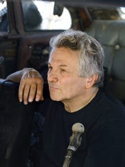 "Director George Miller on the set of ""Mad Max: Fury"