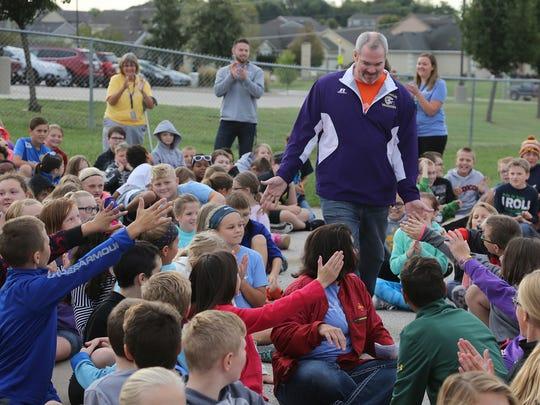 Matt Ramthun, a Lakewood Elementary teacher, is congratulated