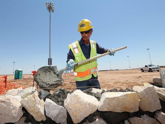 Guadalupe Rivas of Sanchez Construction helps build