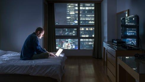 Man using laptop at night.