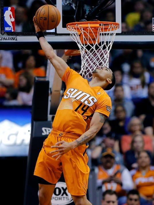 Phoenix Suns' Gerald Green (14) dunks against the Detroit Pistons during the first half of an NBA basketball game, Friday, March 21, 2014, in Phoenix. (AP Photo/Matt York)