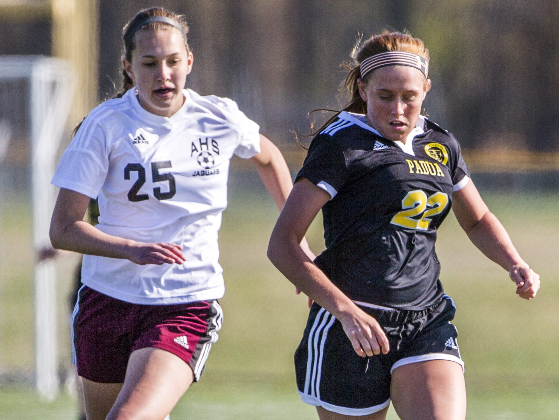 Padua's Mackenzie Scully (No. 22) runs ahead of Appoquinimink's Alison Candy (No. 25) in the second half of Padua's 4-0 win at Appoquinimink this spring.