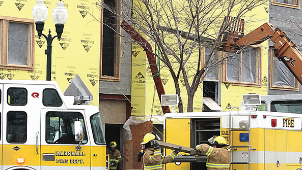 Firemen with the Marshall Fire Department removed bricks