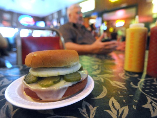"The G&R Tavern's ""world-famous"" bologna sandwich sits"