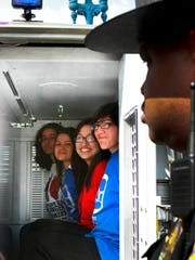 Four of the six young people sit in the back of the police wagon after being arrested for criminal trespass in and outside Indiana Gov. Mitch Daniels' office in the Indiana Statehouse in Indianapolis on Monday, May 9, 2011. Shown left to right, Idamarie Collazo, Sayra Perez, Guadalupe Pimentel and Ana Paola Ruiz Tovar, were protesting two recent state immigration measures. Also arrested were brothers Erick and Omar Gama. Charlie Nye / The Star.