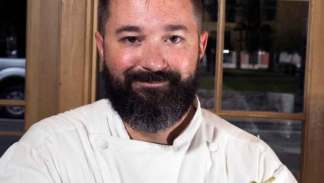 """Chef Jason Perry from Jackson's Steakhouse shows off """"A Trio of Gulf Seafood"""" — pan-roasted snapper with heirloom tomatoes and Florida citrus meunière; fried grouper cheeks with Dijon-lime aioli; and chargrilled oyster with roasted garlic compound butter and small-batch bacon."""