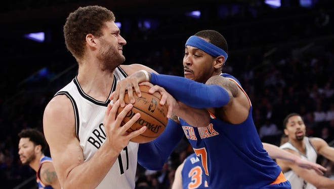 Brooklyn Nets' Brook Lopez (11) and New York Knicks' Carmelo Anthony vie for the ball during the second half of an NBA basketball game Thursday, March 16, 2017, in New York. The Nets won 121-110.