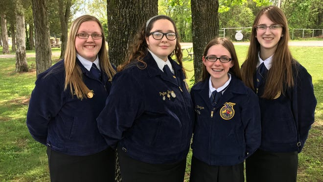 The team of Brenna Cannon (from left), Peyton Barton, Caitlyn Ferguson and Kelsey Rohr captured first place in the Agronomy competition at the state FFA contest in Fayetteville.