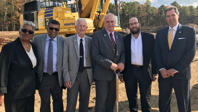 From left: Old Bridge Councilwoman June Dungee, Old Bridge CFO Himanshu Shah, state Sen. Sam Thompson, Mayor Owen Henry, Kennedy International CFO Mendy Reich and Steve Mamakas of the Mayor's Economic Development Office at a groundbreaking for a new warehouse in Old Bridge.