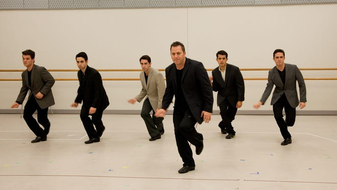 "Actors work on their Frankie Valli moves with associate choreographer Danny Austin (front center) during a Frankie Camp in New York. In order to land the lead role in ""Jersey Boys,"" hopefuls must pass through a weeklong clinic."
