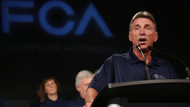 UAW Vice President Norwood Jewell speaks during an event to mark the ceremonial beginning of its contract talks at the UAW-Chrysler National Training Center in Detroit on Tuesday, July 14, 2015.