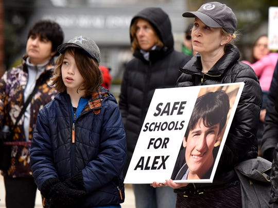 "Jennifer Nelkin of Englewood holds a poster with a photograph of Marjory Stoneman Douglas High School shooting victim Alex Schachter, 14. Schachter is her first cousin's son, and Nelkin has hosted Alex, her cousin Max and his family for holidays. Nelkin attended March for Our Lives event in Teaneck on Sunday, March 25, 2018, with her son, Jonas, 10, and read a poem written by Alex, titled ""Life is Like a Roller Coaster."""
