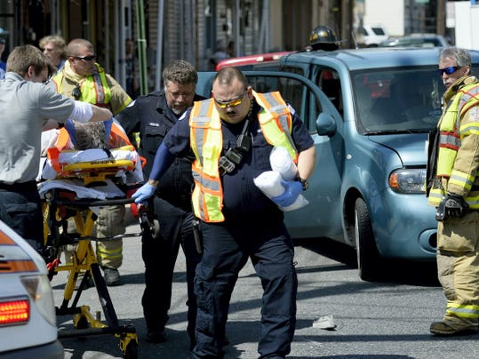 Jeremy Long — Lebanon Daily News Emergency crews tend a victim of a crash at Ninth and Cumberland streets on Saturday about 2 p.m.