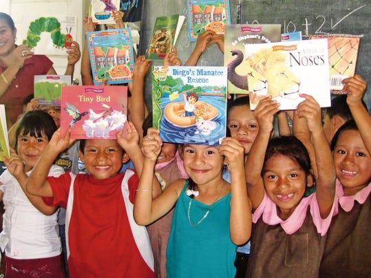Children in Belize receive books through the Better World Books program.