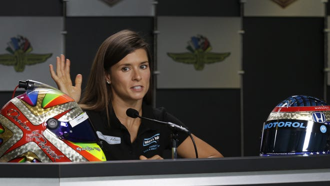 Sprint Cup Series driver Danica Patrick (10) talks about her new design painted by Troy Lee Designs and her old IndyCar helmet on there right, Saturday, July 23, 2016, afternoon at the Indianapolis Motor Speedway.