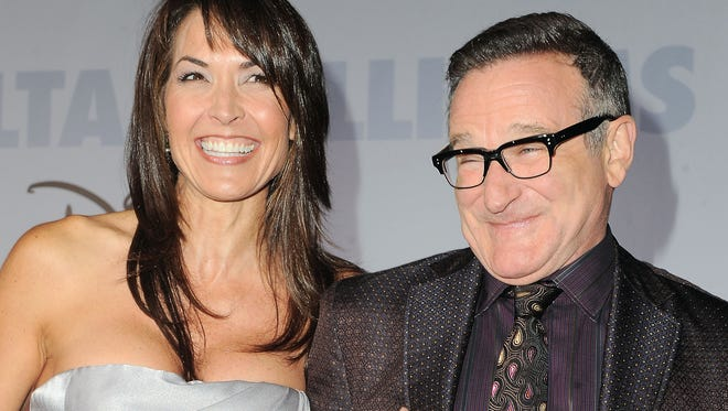 "Robin Williams, right, and  his wife Susan Schneider at the premiere of ""Old Dogs"" in Los Angeles."