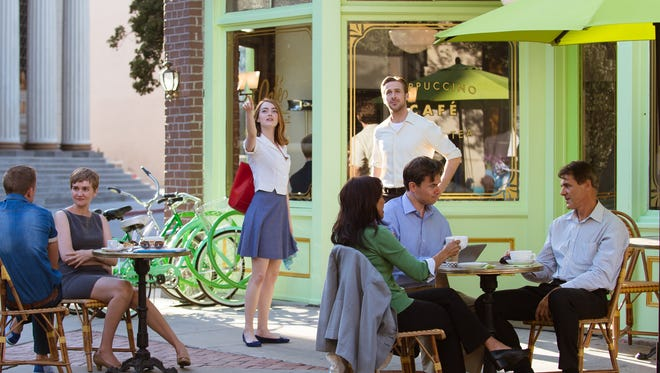 "Actors Emma Stone and Ryan Gosling are seen at Cafe Sur Le Lot, one of the few fictional locations in the Oscar-nominated film ""La La Land."" The reconstructed cafe set is included on Warner Bros. backlot tours through March 6."