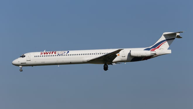 This photo taken on Friday, May 16, 2014, shows an MD-83 aircraft in the livery of Swiftair landing at Zaventem Airport Brussels. An Air Algerie flight carrying over 100 people from Burkina Faso to Algeria's capital disappeared from radar early Thursday over northern Mali after heavy rains were reported, according to the plane's owner and government officials in France and Burkina Faso. Air navigation services lost track of the MD-83 about 50 minutes after takeoff from Ougadougou, the capital of Burkina Faso, at 0155 GMT (9:55 p.m. EDT Wednesday), the official Algerian news agency APS said. Air Algerie Flight 5017 was being operated by Spanish airline Swiftair, the company said in a statement. The Spanish pilots' union said the plane belonged to Swiftair and it was operated by a Spanish crew.