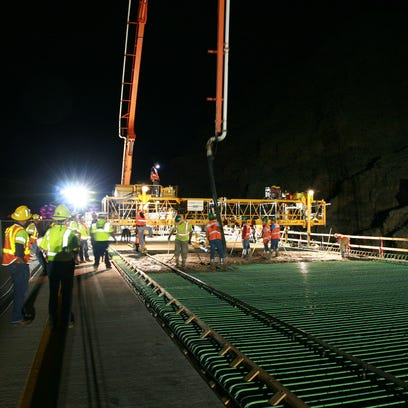 A crew member smoothed concrete on the southbound side of the bridge in Virgin River Gorge.