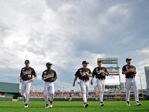 Vanderbilt players warm up before Game 2 on Tuesday.