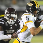 Southern Miss quarterback Nick Mullens under pressure against Mississippi State last season.