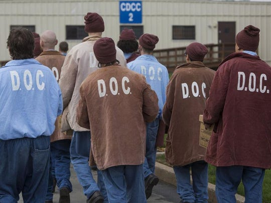 Newly arrived inmates enter the State Correctional Institution at Camp Hill, Pa.