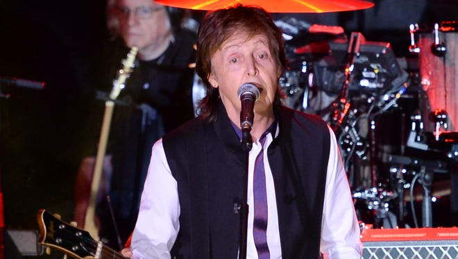 Paul McCartney and his band perform in New York. McCartney will be among 130 acts at this year's Lollapalooza music festival in Chicago. It will be his first appearance at Lollapalooza. The festival, to take place July 31 to Aug. 2, marks its 11-year anniversary in Chicago's Grant Park.