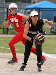 Plymouth first baseman Mikayla Rose (11) charges in while Canton's Peyton Philbeck (9) rounds the base.