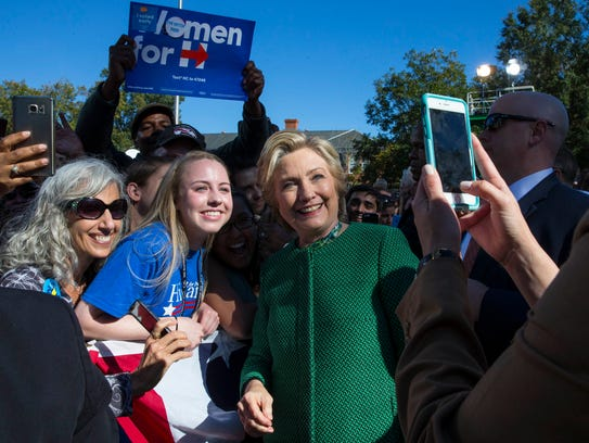 Hillary Clinton poses for a photo while greeting supporters